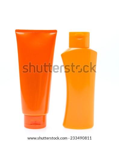 Bottle suntan cream isolated on white background - stock photo