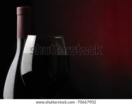bottle with a wineglass - stock photo