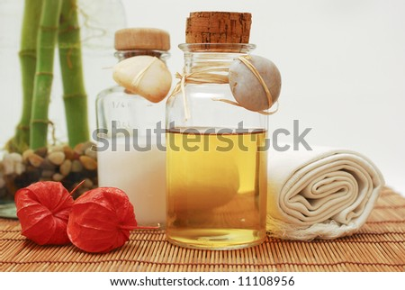 Bottle with aromatic oil or soap and towels - Accessories for wellness, spa or relaxing - stock photo