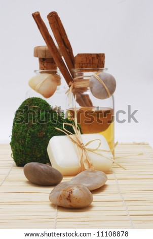 Bottle with aromatic oil, soap and zen stones - Accessories for wellness, spa or relaxing