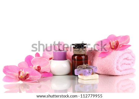 Bottle with aromatic oils with accessories for relaxation isolated on white - stock photo