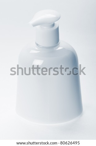 Bottle with color liquid soap on the white background.