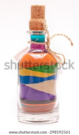 bottle with colorful sand - stock photo