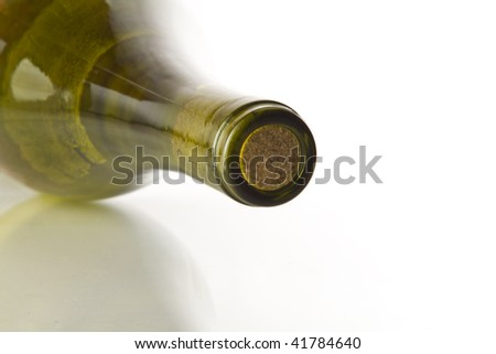 Bottle with grapes wine, corked. Shallow dof, focus is on the top of the cork. - stock photo