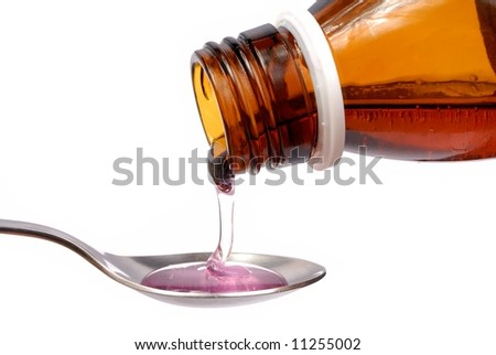 Bottle with medicine and spoon isolated on white - stock photo