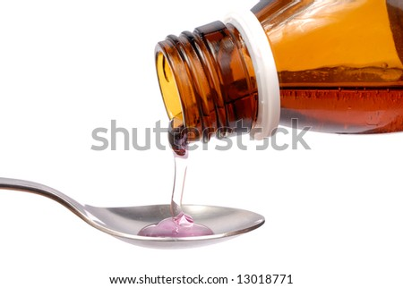 Bottle with medicine and spoon isolated on white