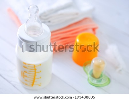 bottle with milk for baby - stock photo