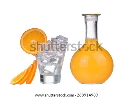 Bottle with orange juice, glass with ice cubes, slice and water - stock photo