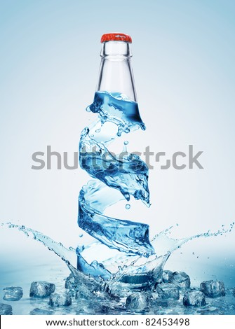 Bottle with pure water and splash around it - stock photo