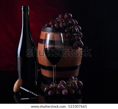 Bottle with red vine. Barrel, bottle and wineglass