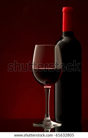 bottle with red wine and glass and grapes - stock photo