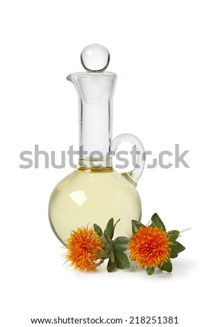 Bottle with Safflower oil on white background - stock photo