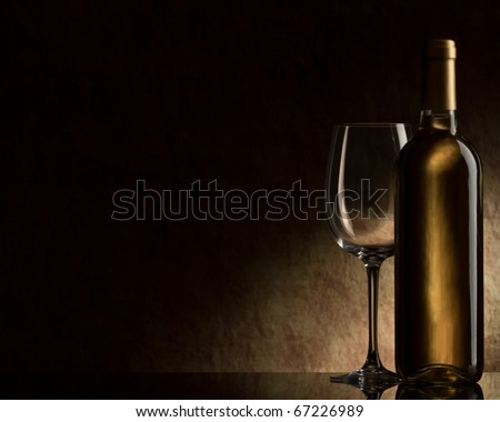 bottle with white wine and glass - stock photo