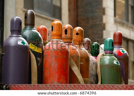 bottled gas cylinders awaiting delivery - close up detail - stock photo