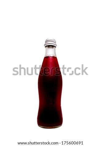 Bottled grape juice over white background - stock photo