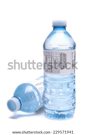 Bottled water close up shot isolated on the white background, shallow focus - stock photo