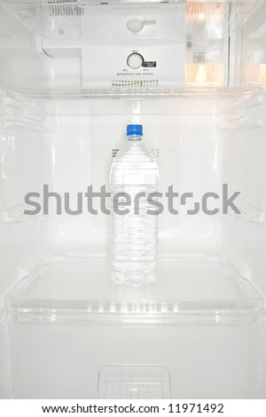 Bottled water in new refrigerator - stock photo