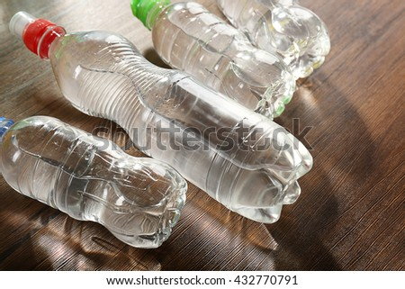 Bottled water on the wooden table,close up - stock photo