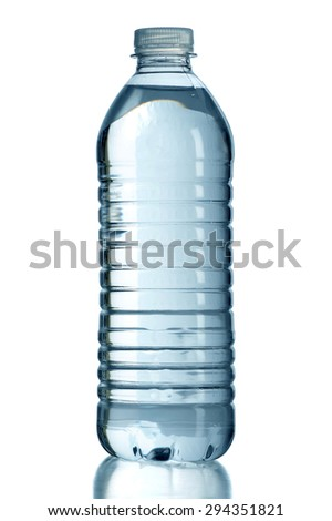 Bottled water with reflection on table isolated over white background - With clipping path on bottle - stock photo