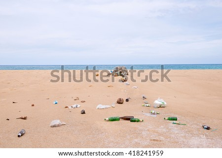bottles and garbage waste on the beach - stock photo