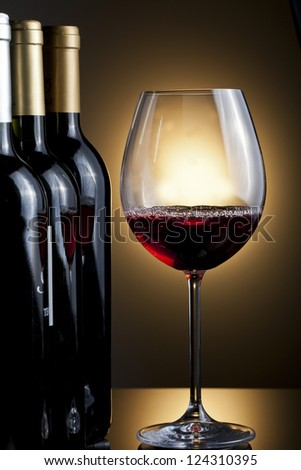 Bottles and glass of wine - stock photo