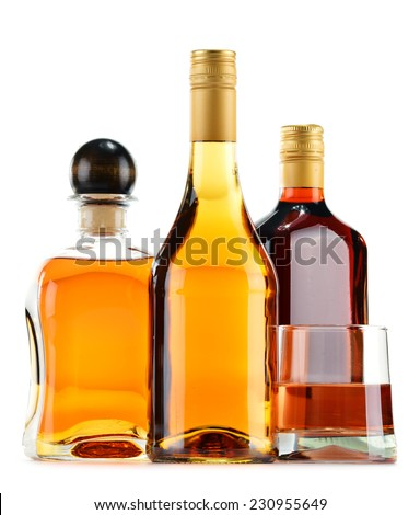 Bottles and glasses of alcoholic beverages isolated on white background - stock photo