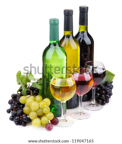 bottles and glasses of wine and assortment of grapes, isolated on white - stock photo