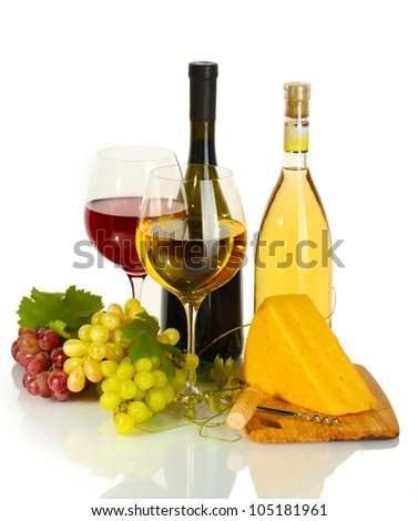 bottles and glasses of wine, cheese and ripe grapes isolated on white