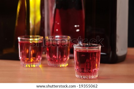 Bottles and glasses with alcoholic drinks