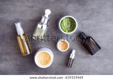 Bottles And Jars With Natural Skincare Cosmetics Creams Oils On Dark Background Plant