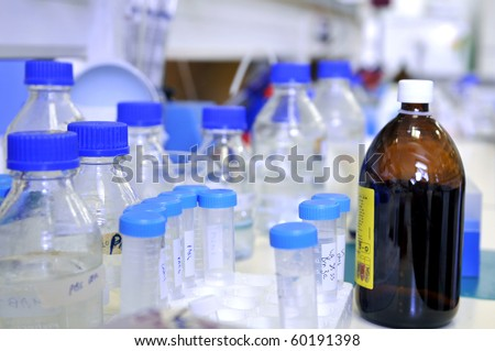 Bottles and tubes in research laboratory - stock photo