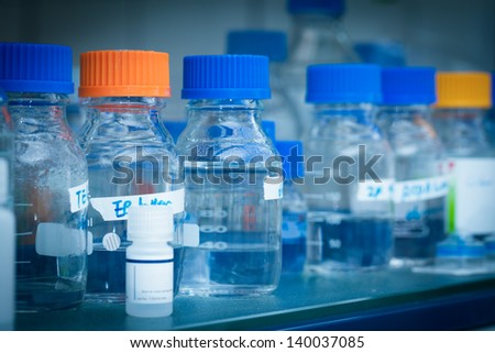 Bottles in a laboratory chemicals - stock photo