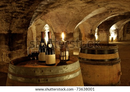 bottles in ambiance in an old cellar in burgundy in france - stock photo