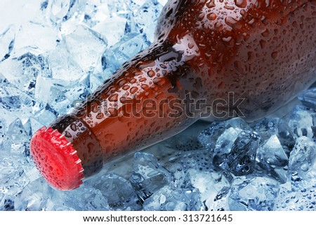 Bottles in ice close up - stock photo
