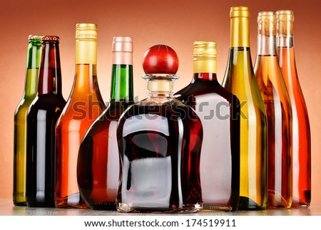 Bottles of assorted alcoholic beverages including beer and wine - stock photo
