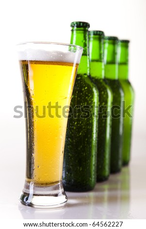 Bottles of beer against a white background - stock photo
