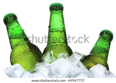 Bottles of beer are in ice on white background