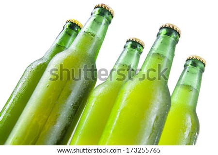 Bottles of beer with drops isolated on white background - stock photo