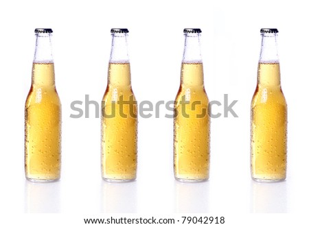 Bottles of beer with water drops isolated on white