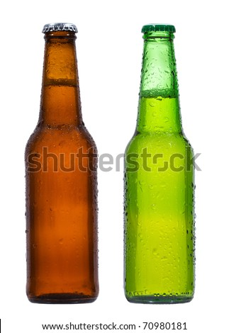 Bottles of beer with water drops on white background - stock photo