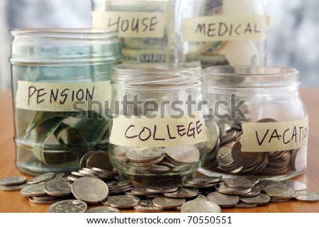 Bottles of cash with coins isolated on the background. - stock photo