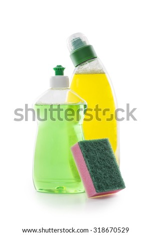 Bottles of cleaning liquids and sponge isolated on white background - stock photo