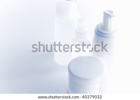 Multicolored cosmetic bottle equals on the table stock photo