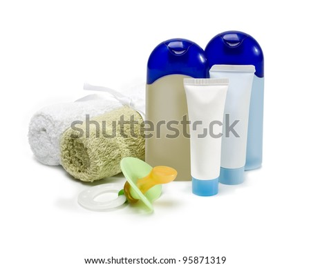 bottles of cosmetics for the care of the newborn on a white background - stock photo