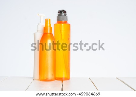 Bottles of cosmetics for the hair isolated on white background