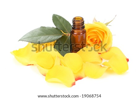 bottles of essential oil and beautiful rose isolated - stock photo