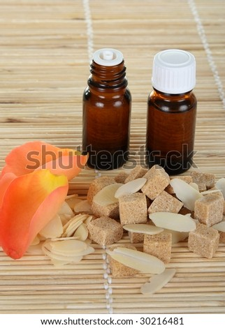 "bottles of essential oil, composition of ""brown sugar and almond spa"" - stock photo"
