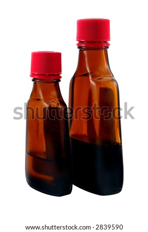 bottles of flavor extract (isolated on white) - stock photo