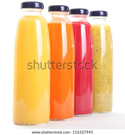 Bottles of fruit juice isolated on white background - stock photo