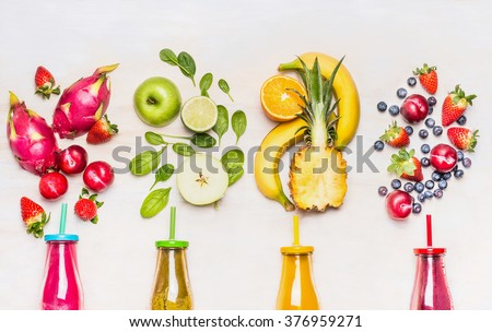 Bottles of Fruits smoothies with various ingredients on white wooden background, top view.  Superfoods and healthy lifestyle or detox  diet food concept. - stock photo